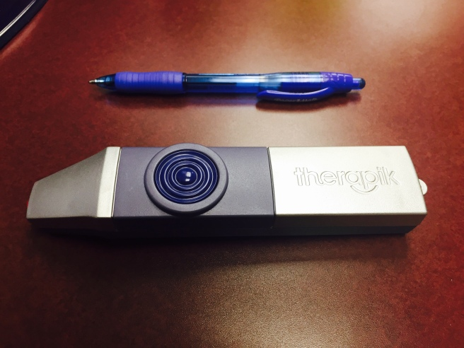 The Therapik next to a pen for scale.