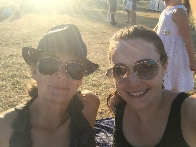 My friend Chloe (left) and me enjoying the show from the back of the crowd at the main stage.