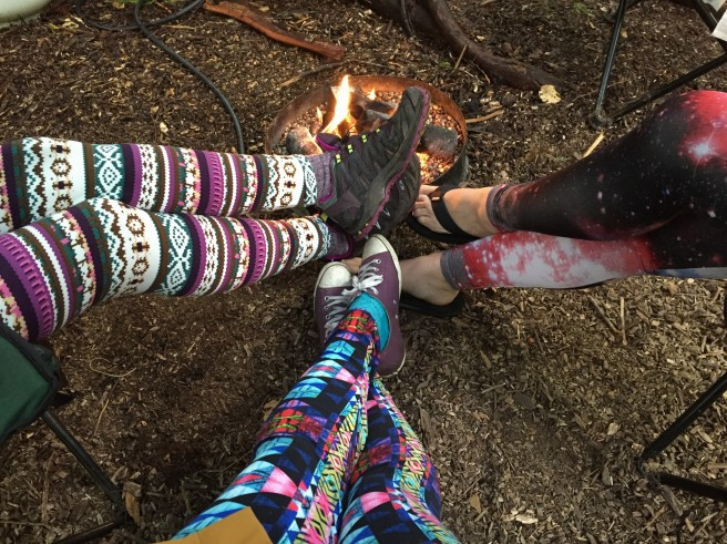 Keeping warm around the fire in our funky leggings (left and centre are from sweetlegs.ca and right are from Target).